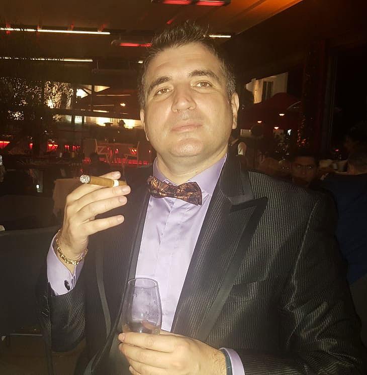 Hristo Vasilev Cannes smoking cigar